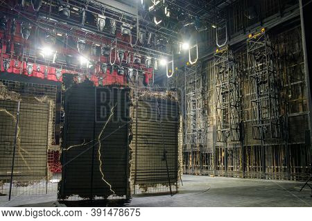 Technical Equipment At The Backstage Of Theater. Stage Spot Lighting Rigging Structure For A Live Mu
