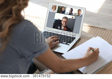 Business Woman Talking To Her Colleagues In Video Conference. Businessteam Working From Home Using L
