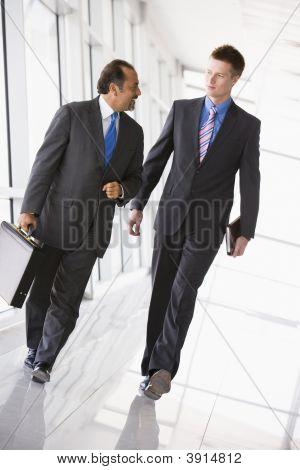 Middle Eastern / Western Business Men Walking Down Corridor
