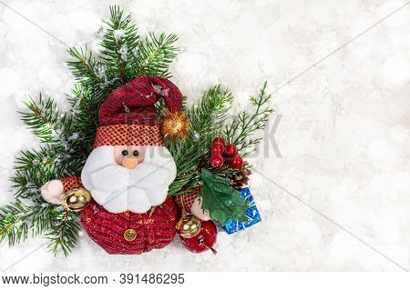 Christmas Background With Pine Branches, Holly Branches With Red Berries And Santa Claus On A White