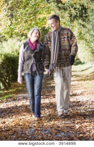 Couple Walking Through Woodland