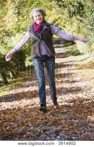 Woman Running Through Woodland