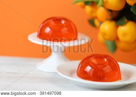 Tangerine Jelly.orange Mandarin Jelly Desserts On A White Wooden Table And A Tangerine Tree With Rip