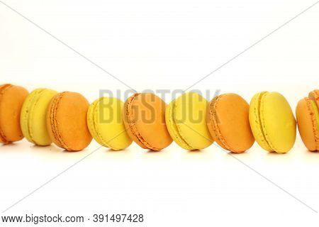 Isolated Macaroon On A White Background. Popular Dessert. Photo For Formula. Macaroons In The Studio