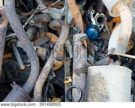Old Car Garage Repair Service Close Up With Dirty Exhaust Chamber Silencer Muffler. Closeup Of Servi