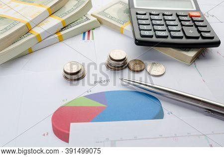 Business And Finance Concept With Calculator, Financial Papers, Documents With Diagrams And Money, C