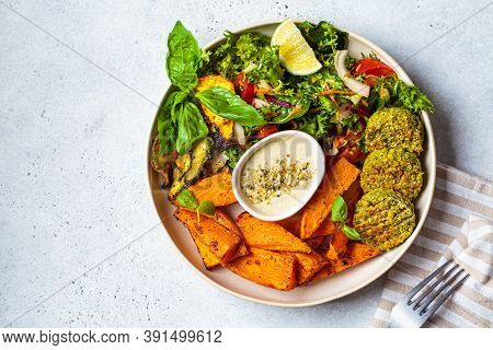 Falafel Salad Bowl. Vegan Lunch Plate - Baked Chickpea Cutlets With Baked Sweet Potatoes And Vegetab