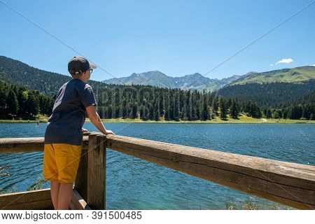 Boy Looking A Lake Of Payolle In The French Pyrenees