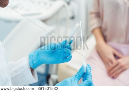 Gynecologist testing vaginal swab for STD, close-up