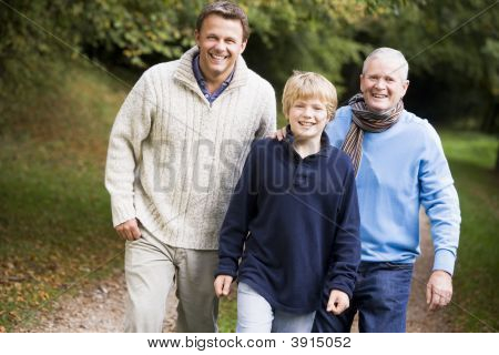 Men And Child On Wlak Together