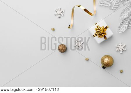 Christmas Gift With Decoration On Gray Background