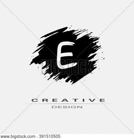 Letter E Logo With Brush Stroke And Splatter Elements. Handwritten Brush Stroke Letter E Logo Design