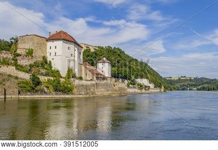 Waterside Impression Of Passau Including The Veste Niederhaus In Lower Bavaria In Germany At Summer