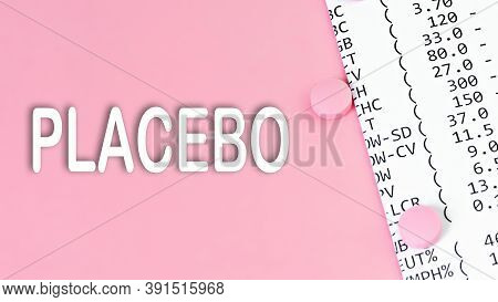 Word Placebo On Pink Background With A Pills And Financial Documents, Medical Concept, Top View