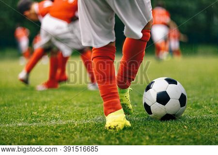 Youth Soccer Team Training. Boys Kicking Soccer Ball On Grass Venue. Junior Soccer Drills. Kids Socc