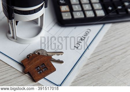 Mortgage Loan Agreement Application With Wooden House Shaped Keyring. Savings Concept