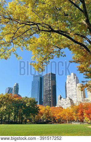 Manhattan midtown skyline viewed from central park in Autumn in New York City.