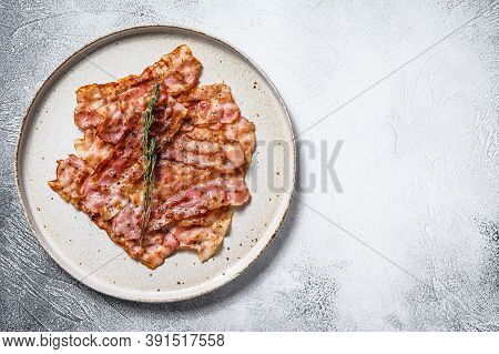 Sizzling Hot Bacon Pieces. Organic Meat. Gray Background. Top View. Copy Space