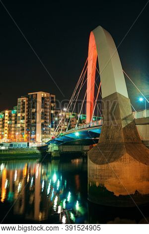 GLASGOW, UK - FEB 26, 2020: Closeup view of the Clyde Arc or Squinty Bridge at night as the modern landmark of the city in Scotland, United Kingdom