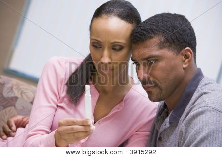 Couple Looking At Negative Home Pregnancy Test