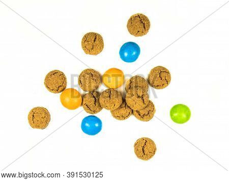 Bunch Of Scattered Pepernoten Cookies And Sweets From Above On White Background For Annual Sinterkla