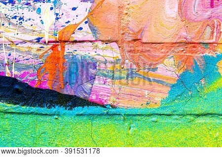 A Fragment Of Colorful Graffiti Painted On A Brick Wall. Abstract Backdrop For Design.