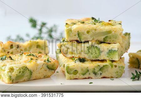 Homemade Frittata With Broccoli, Cheese And Peas.