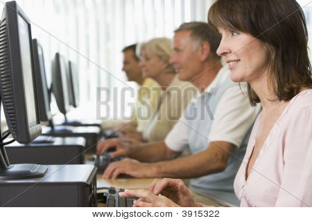 Group Of Adults On Computers