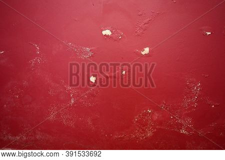 A Red Interior Wall Damaged By Damp