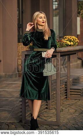 Silk Velvet. Glamour Velvet Textile. Sexy Woman Outdoors. Modern Life. Girl Carry Handbag. Glamorous
