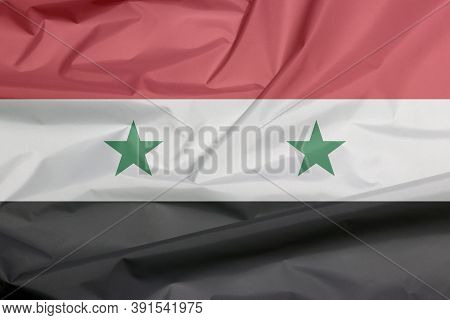 Fabric Flag Of Syrian Arab Republic. Crease Of Syrian Flag Background, A Horizontal Tricolor Of Red