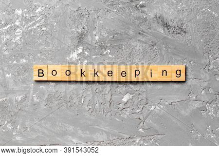 Bookkeeping Word Written On Wood Block. Bookkeeping Text On Table, Concept