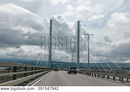 Inverness, Scotland - August 7, 2019: Kessock Bridge In Inverness, Scotland At Road A9 In Cloudy Aft