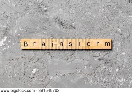 Brainstorm Word Written On Wood Block. Brainstorm Text On Table, Concept