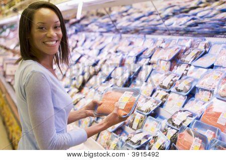 Woman Choosing Meat From Shop