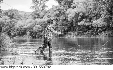 Rural Sports. Retired Bearded Fisher. Trout Bait. Mature Man Fly Fishing. Man Catching Fish. Fisherm