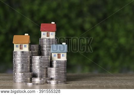 Business Property Investment House And Stacking Coins Saving Growth On Wooden Desk And Green Backgro