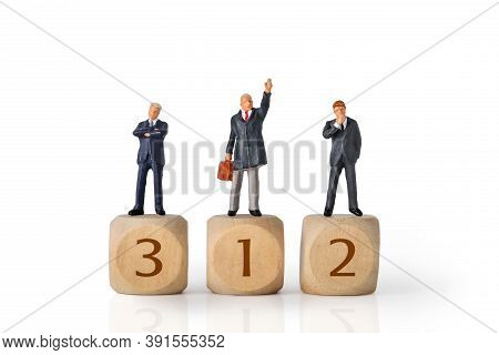 Miniature People: Businessman Standing On Wooden Podium No.1, 2 And 3 With Reflection And Isolated W