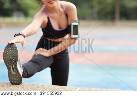 City Public Exercise Lifestyle Concept, Fitness Woman Listening Music From Wireless Earphones And Mo
