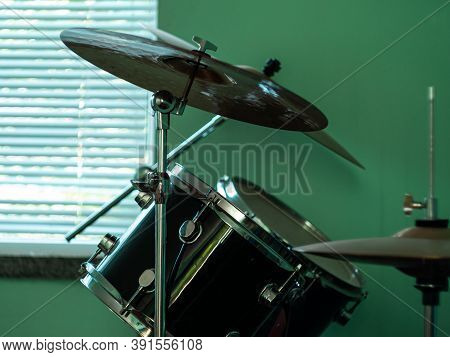 Black Drum Kit Close-up. Musician Set With Mix Of Drums. Musical Instruments Devices For Drumming Pe