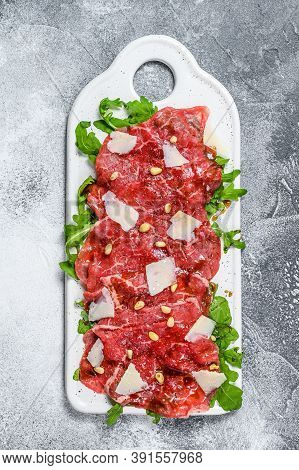 Carpaccio Made Of Raw Marbled Beef. Gray Background. Top View