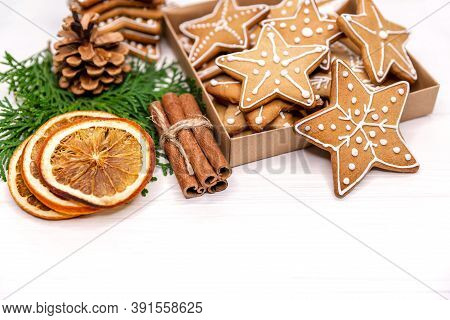 Variety Of Christmas Gingerbread Cookies In Box, Oranges, Xmas Tree On White Background With Copy Sp