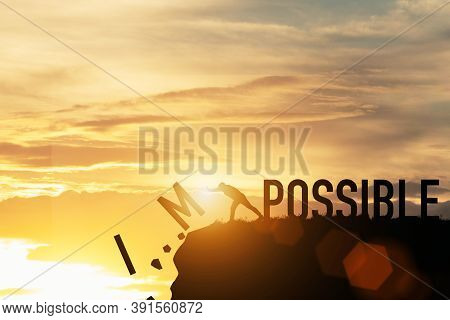 Businessman Push Impossible Wording To Possible Wording On Top Of Mountain With Sunlight. Positive M