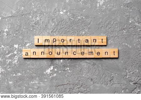 Important Announcement Word Written On Wood Block. Important Announcement Text On Cement Table For Y