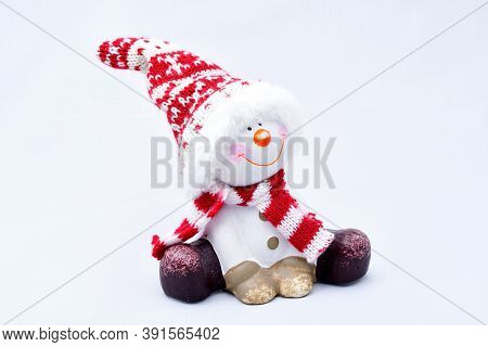 Tired Snowman, Joyful, Sitting, In A Cap, Bright Scarf, On A White Background