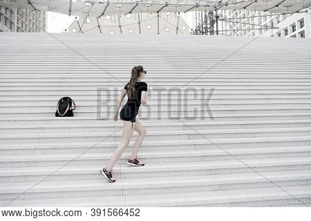 Kick Feet Up And Go. Energetic Woman Climb Stairs Outdoors. Active Life. Freedom From Care. Free And