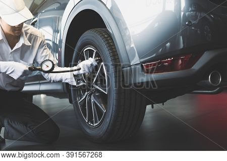 Asian Man Inspection Measure Quantity Inflated Rubber Tires Car Close Up Hand Holding Machine Inflat