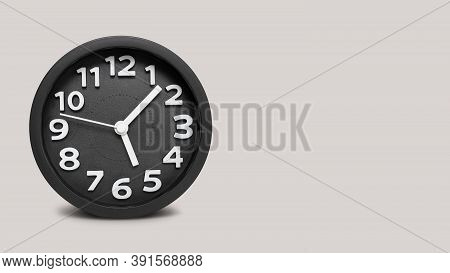 Closeup Black Round Alarm Clock On Grey Background With Copy Space,\ntime Concept With Black Clock A