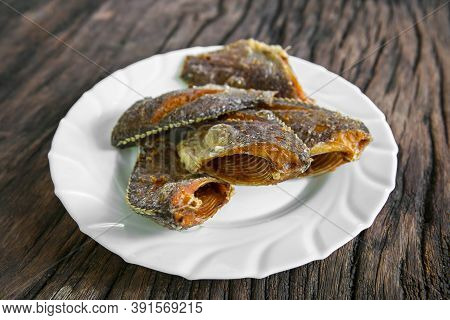 Deep Fried Tilapia Fish After Fried On Dish Ready To Eat. Concept Of Thai Style Homemade Food