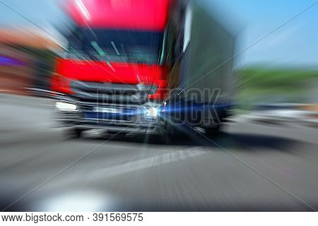 Truck With Red Cab On The Road In Motion. Accident Rate. View From The Cab Of The Car